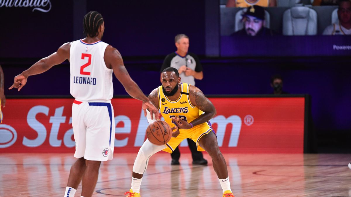 Orlando, FL - JULY 30: LeBron James #23 of the Los Angeles Lakers plays defense against Kawhi Leonard #2 of the LA Clippers on July 30, 2020 at The Arena at ESPN Wide World Of Sports Complex in Orlando, Florida. NOTE TO USER: User expressly acknowledges a