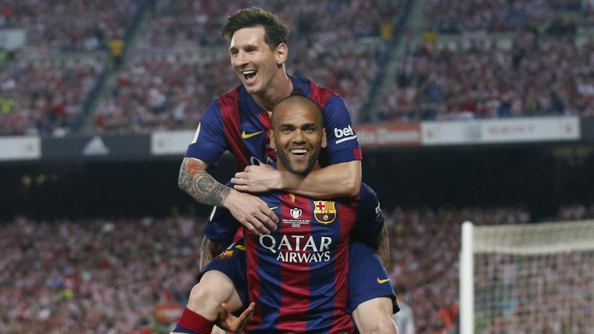 Lionel Messi celebrates with Dani Alves after scoring the third goal for Barcelona