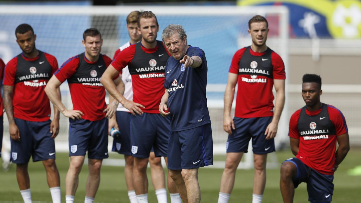 England's manager Roy Hodgson talks to players in training