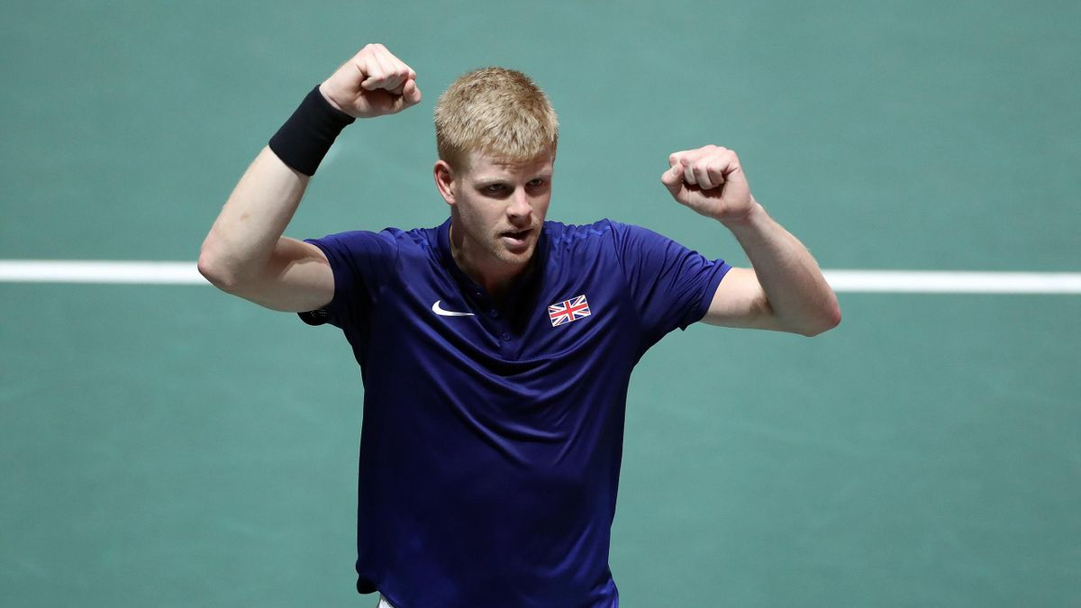 Kyle Edmund of Great Britain celebrates winning match point during his quarter final match against Philipp Kohlschreiber of Germany on Day Five of the 2019 Davis Cup at La Caja Magica
