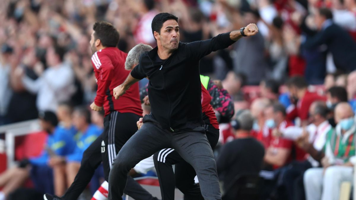 Mikel Arteta, Manager of Arsenal celebrates their side's third goal scored by Bukayo Saka of Arsenal (not pictured) during the Premier League match between Arsenal and Tottenham Hotspur at Emirates Stadium on September 26, 2021 in London, England