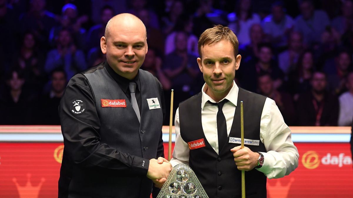 Stuart Bingham and Ali Carter pose for a photo infront of the trophy during the Final of the Dafabet Masters between Stuart Bingham and Ali Carter at Alexandra Palace on January 19, 2020 in London, England