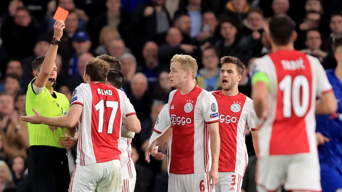 Daley Blind of AFC Ajax is shown a red card during the UEFA Champions League group H match between Chelsea FC and AFC Ajax at Stamford Bridge on November 5, 2019 in London, United Kingdom.