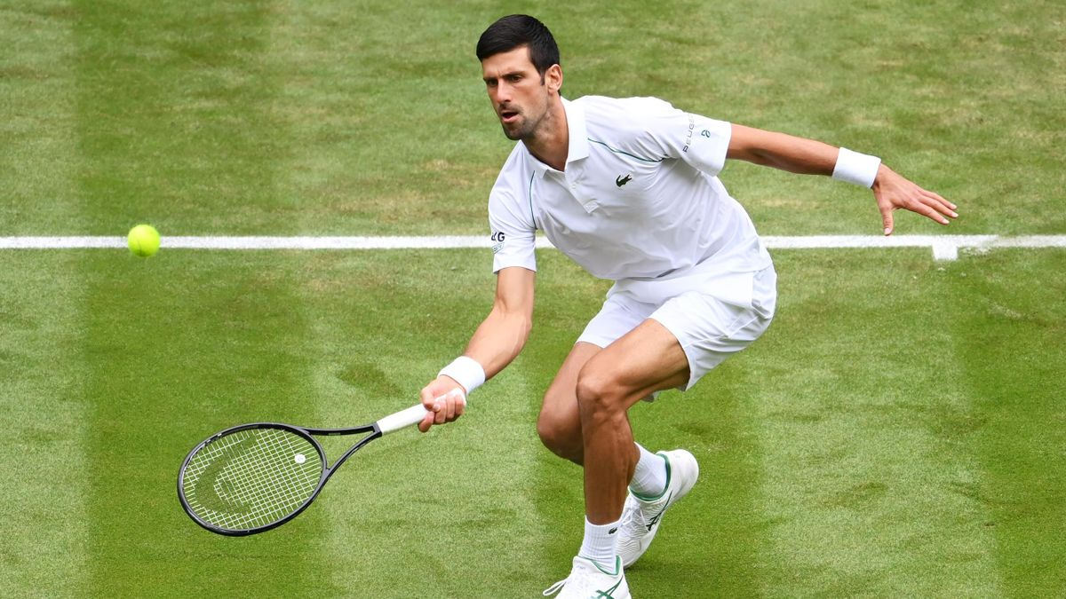 Novak Djokovic of Serbia plays a forehand in his Men's Singles Second Round match against Kevin Anderson of South Africa during Day Three of The Championships