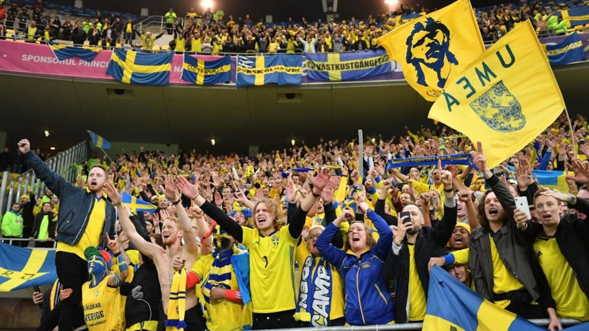 Fans of Sweden celebrate qualification after winning the Euro 2020 Group F qualification football match Romania v Sweden in Bucharest