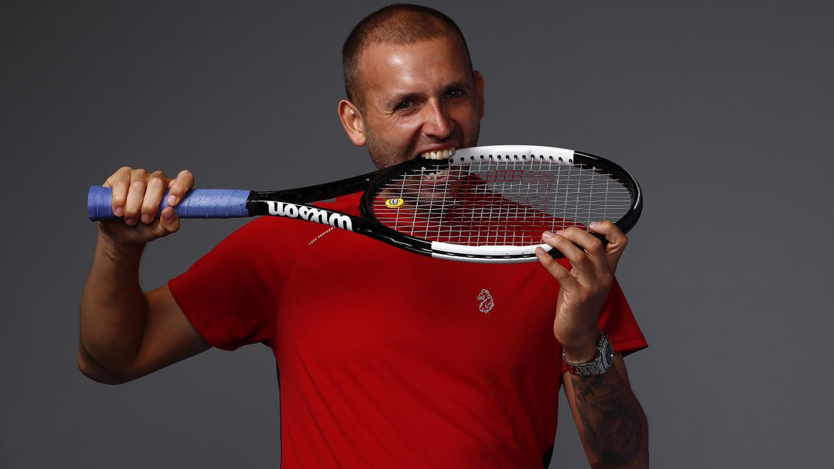 Dan Evans poses with his racquet