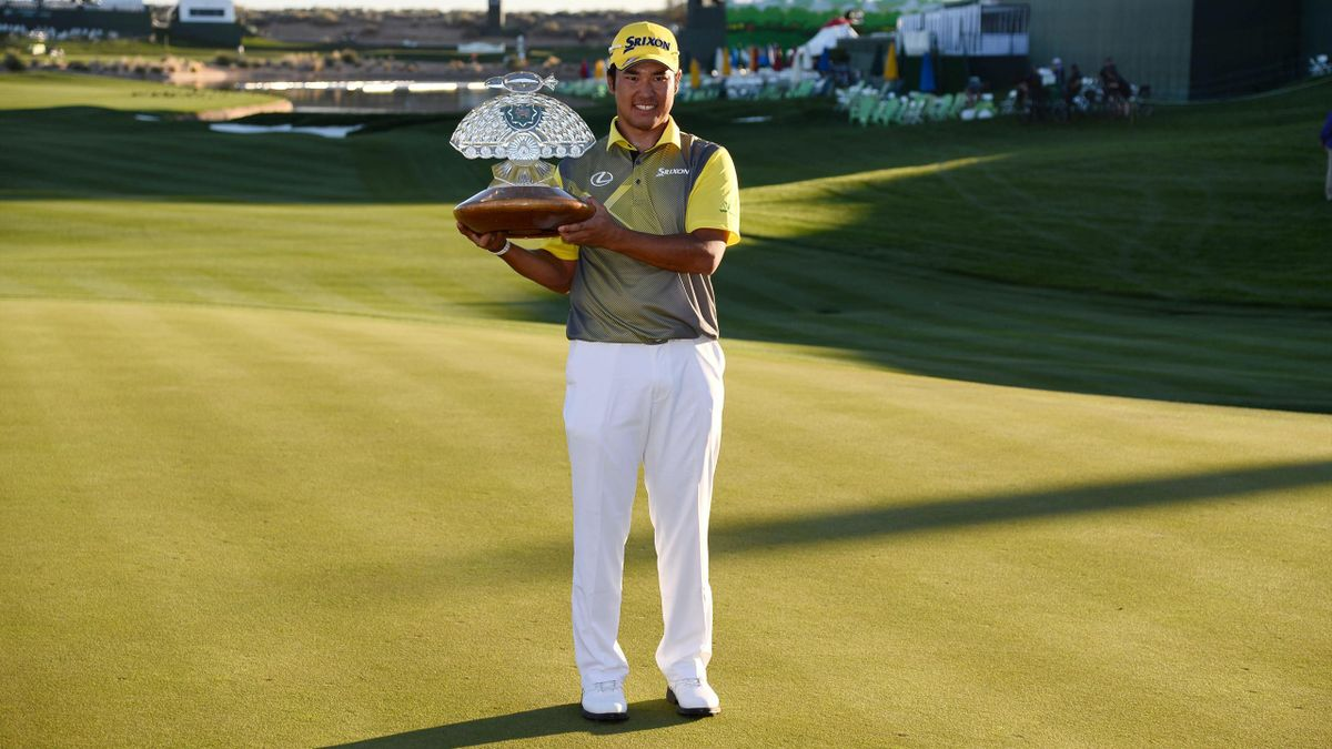 Hideki Matsuyama poses with the trophy after the final round of the Waste Management Phoenix Open golf tournament at TPC Scottsdale. Mandatory Credit: Joe Camporeale-USA TODAY Sports