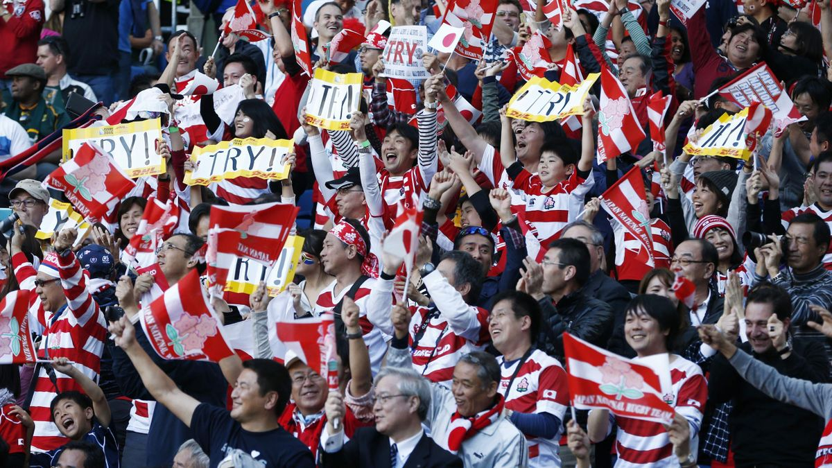 Japan fans celebrate as their team stun South Africa at the Rugby World Cup