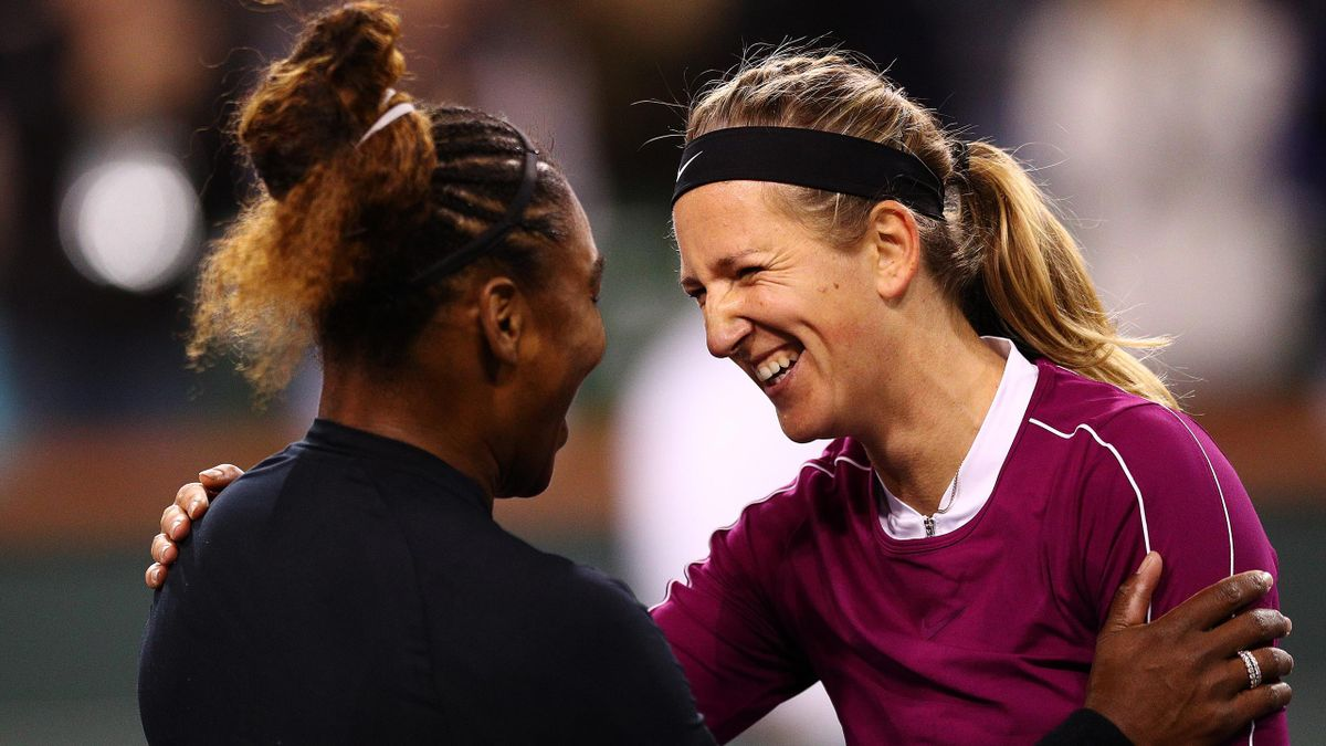 Serena Williams of the United States shares a moment with Victoria Azarenka of Belarus a