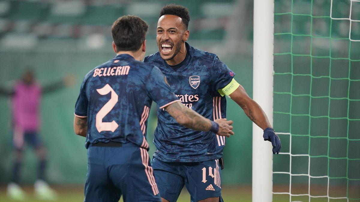 Pierre-Emerick Aubameyang of Arsenal celebrates with team mate Hector Bellerin