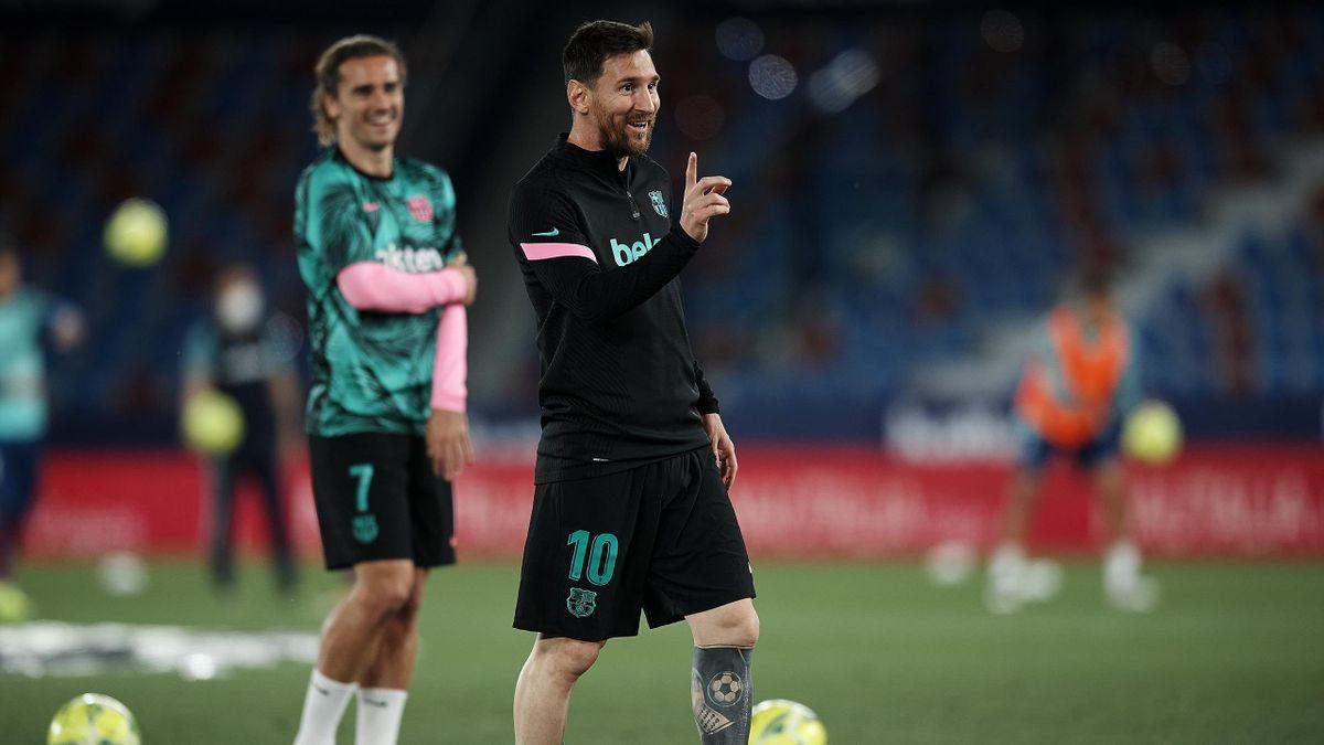 Lionel Messi (vorne) und Antonie Griezmann vom FC Barcelona