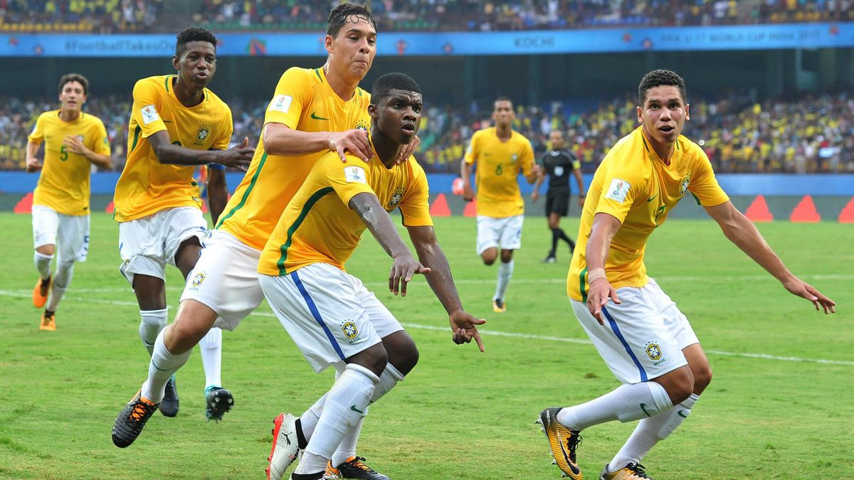Lincoln (C) of Brazil celebrates after scoring a goal against Spain with teammates during their group stage football match of the FIFA U-17 World Cup at Jawaharlal Nehru International Stadium in Kochi