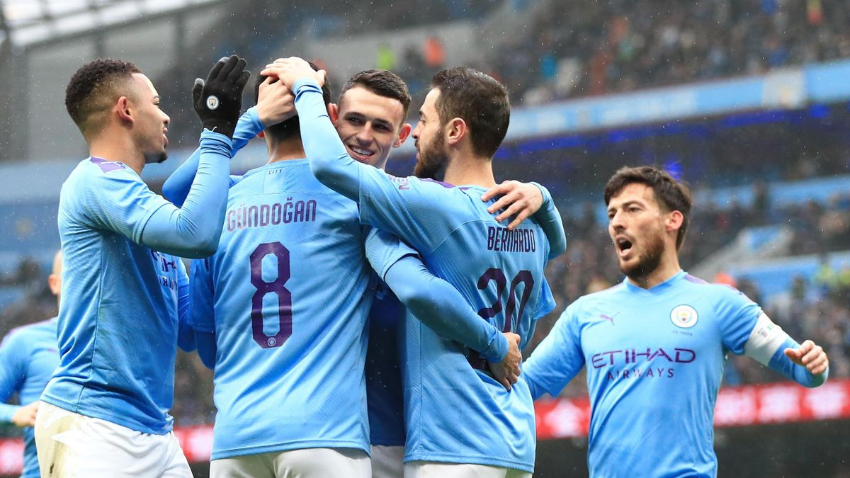 Ilkay Gundogan of Manchester City celebrates after scoring his team's first goal with team mates during the FA Cup Fourth Round match between Manchester City and Fulham at Etihad Stadium on January 26, 2020 in Manchester, England.
