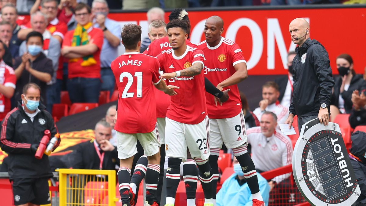 MANCHESTER, ENGLAND - AUGUST 14: Jadon Sancho of Manchester United replaces teammate Daniel James during the Premier League match between Manchester United and Leeds United at Old Trafford on August 14, 2021 in Manchester, England. (Photo by Catherine Ivi