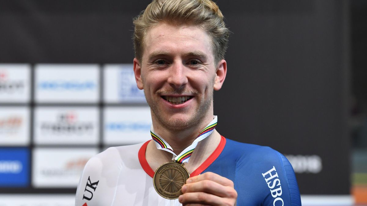 Bronze medalist Britton Mark Stweart poses on the podium after the men's points race final during the UCI Track Cycling World Championships in Apeldoorn on March 2