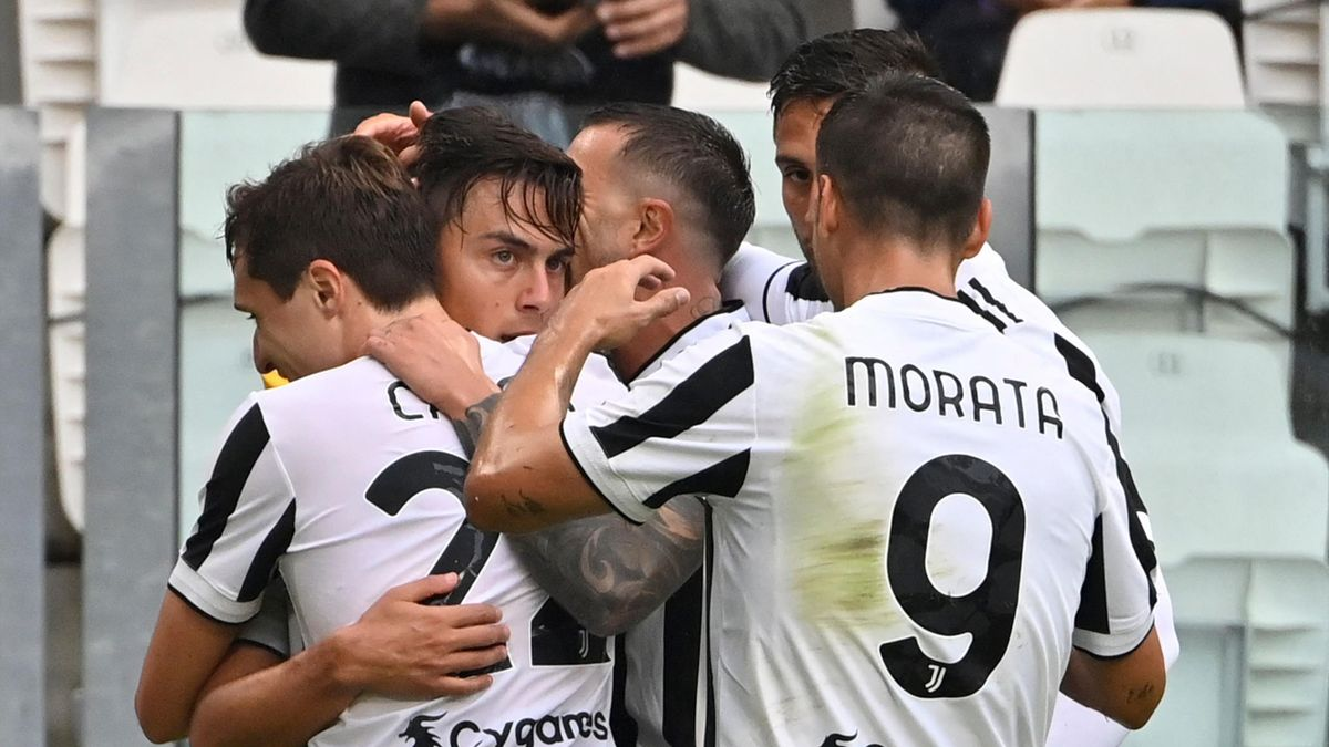 Juventus' Argentine forward Paulo Dybala (2ndL) celebrates after opening the scoring during the Italian Serie A football match between Juventus and Sampdoria on September 26, 2021 at the Juventus stadium in Turin.