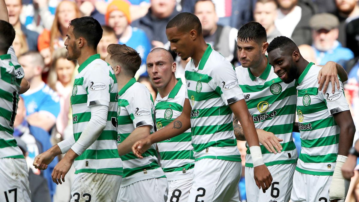 Odsonne Edouard of Celtic celebrates with teammates after scoring his team's first goal during the Ladbrokes Premiership match between Rangers and Celtic at Ibrox Stadium on September 01, 2019 in Glasgow, Scotland.