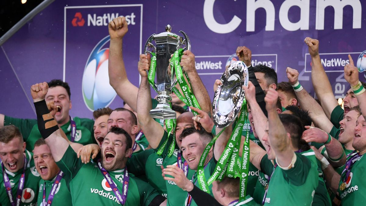 The Ireland team celebrate with the NatWest Six Nations trophy and the Triple Crown Trophy after the NatWest Six Nations match between England and Ireland at Twickenham Stadium on March 17, 2018 in London, England.