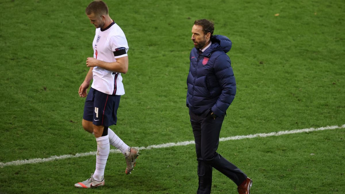 England's defender Eric Dier (L) and England's head coach Gareth Southgate leave the pitch at the end of the UEFA Nations League football match between Belgium and England, on November 15, 2020