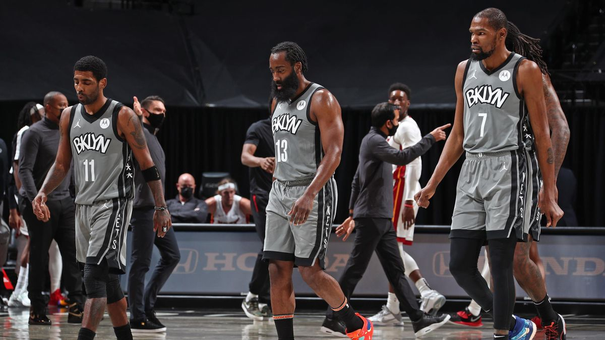 Kyrie Irving #11, James Harden #13 and and Kevin Durant #7 of the Brooklyn Nets walk off the court during the game against the Miami Heat on January 25, 2021