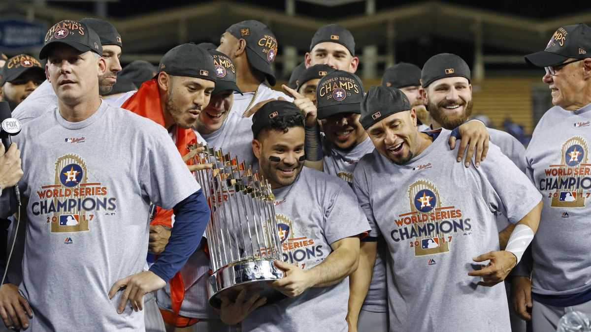 Jose Altuve (C) of the Houston Astros holds the World Series championship trophy after a 5-1 victory over the Los Angeles Dodgers in Game 7 of the World Series at Dodger Stadium on Nov. 1, 2017