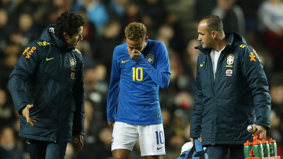 Brazil's Neymar leaves the pitch after sustaining an injury
