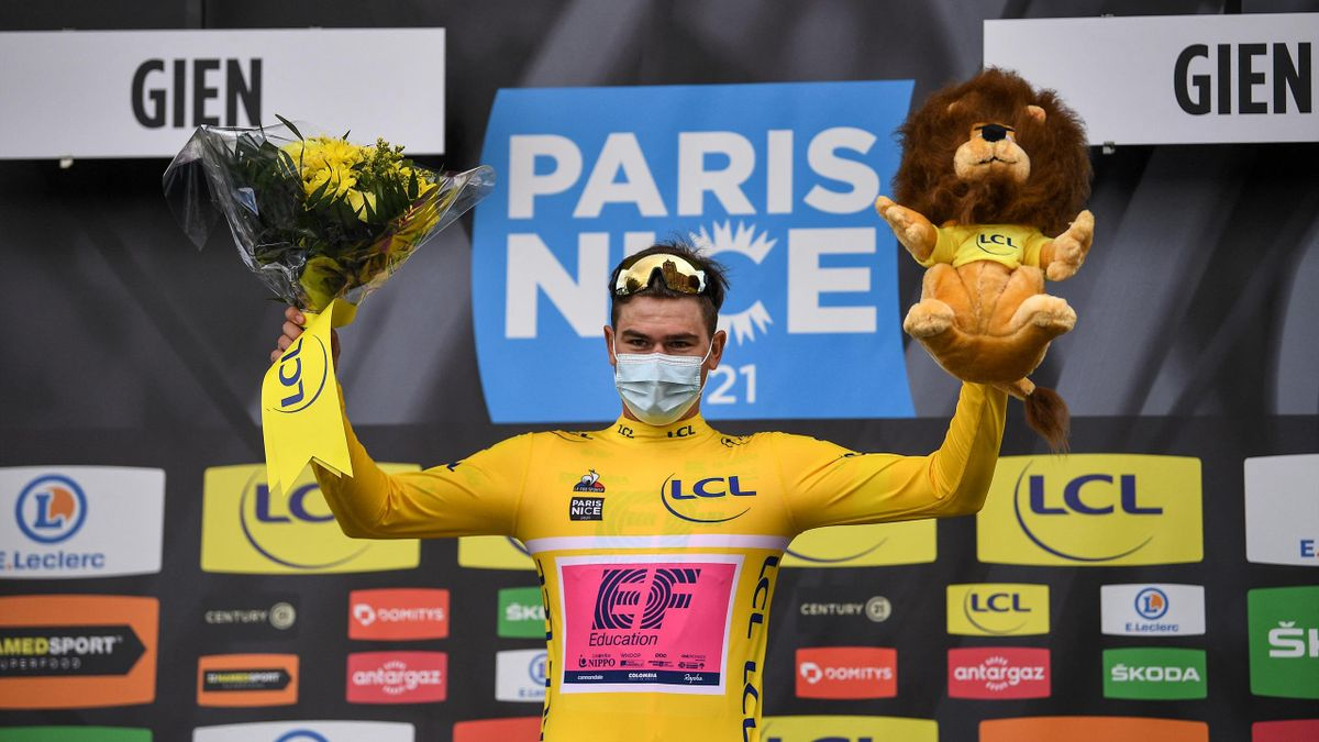 Team Education First rider Switzerland's Stefan Bissegger celebrates his overall leader yellow jersey on the podium after winning the 3rd stage of the 79th Paris - Nice