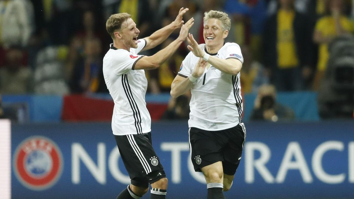 Germany's Bastian Schweinsteiger celebrates with team mates after scoring their second goal