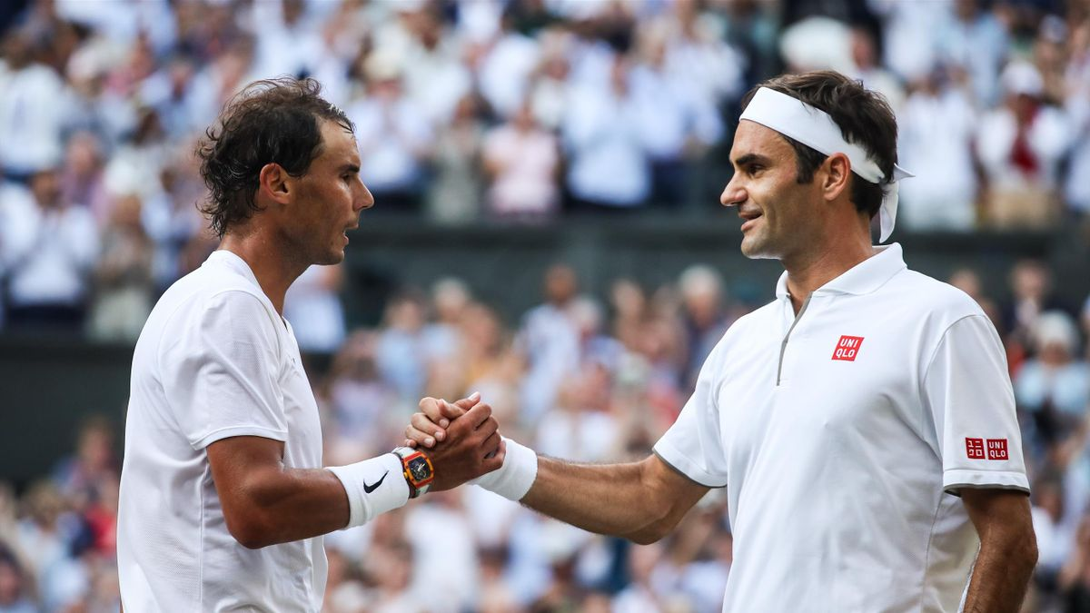 Roger Federer (R) of Switzerland shakes hands with Rafael Nadal of Spain after their Men's Singles semi-final match during Day eleven of The Championships