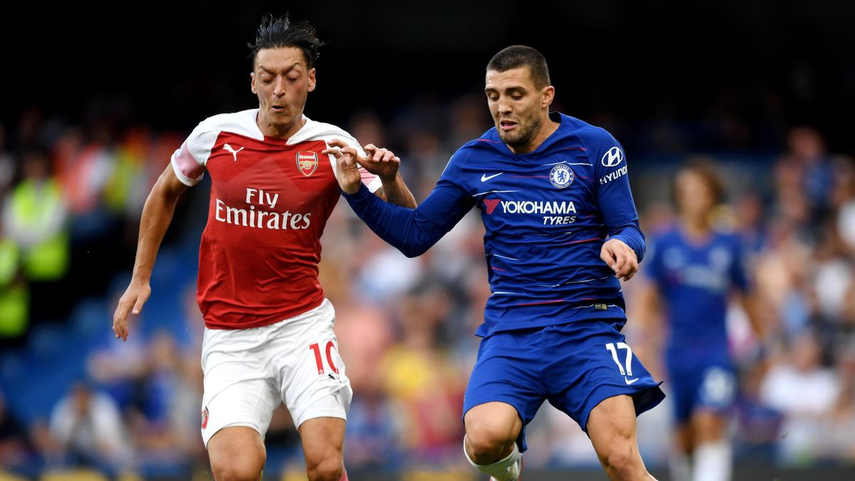 Mesut Ozil of Arsenal and Mateo Kovacic of Chelsea