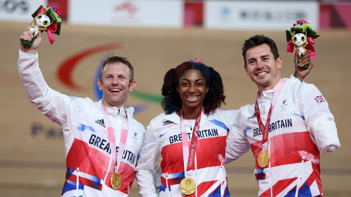 IZU, JAPAN - AUGUST 28: (L-R) Jody Cundy, Kadeena Cox and Jaco van Gass of Team Great Britain react after winning the gold medal in the Mixed C1-5 750m Team Sprint track cycling on day 4 of the Tokyo 2020 Paralympic Games at Izu Velodrome on August 28, 20