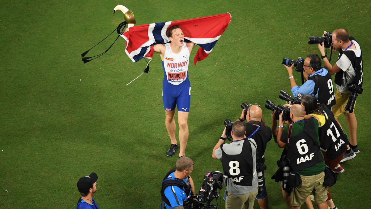 Karsten Warholm of Norway poses for photographers as he celebrates winning gold in the Men's 400 metres hurdles final during day four of 17th IAAF World Athletics Championships Doha 2019 at Khalifa International Stadium on September 30