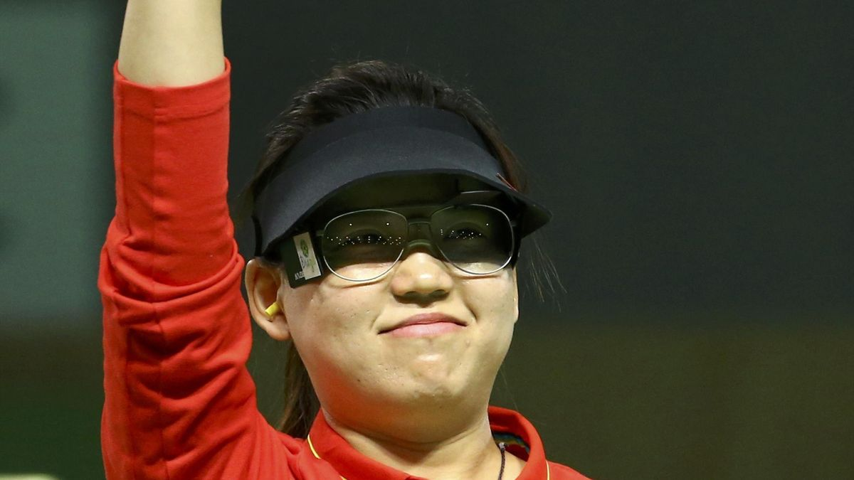 Zhang Mengxue (CHN) of China (PRC) gestures after winning the 10m air pistol