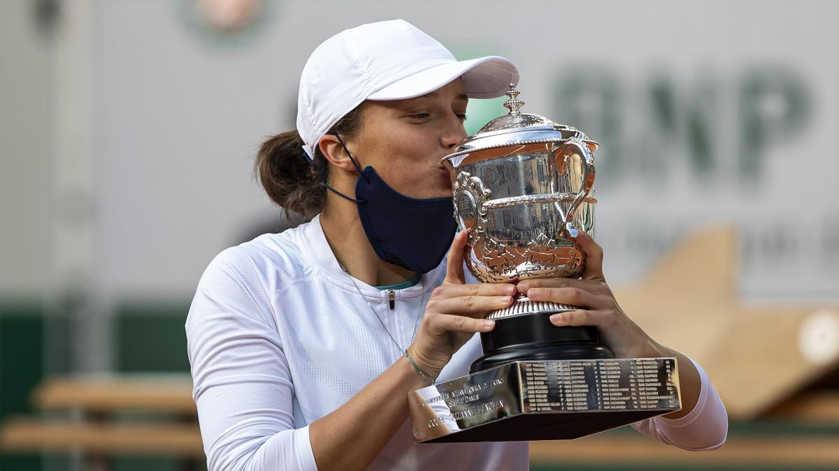Iga Swiatek of Poland celebrates with the trophy after her victory over Sofia Kenin of the United States in the final of the women's singles at Roland Garros on October 10, 2020 in Paris, France