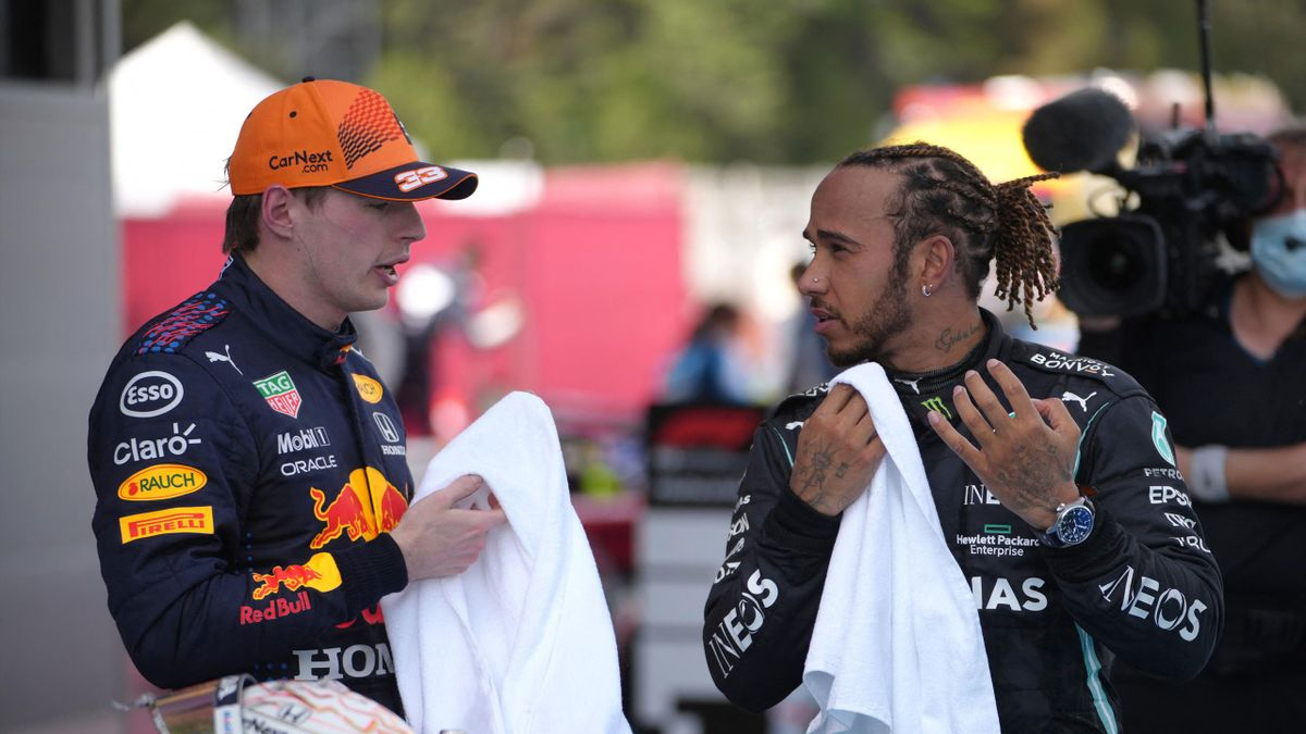 Mercedes' British driver Lewis Hamilton talks to Red Bull's Dutch driver Max Verstappen after the Spanish Formula One Grand Prix race at the Circuit de Catalunya on May 9, 2021 in Montmelo on the outskirts of Barcelona. (Photo by Emilio Morenatt