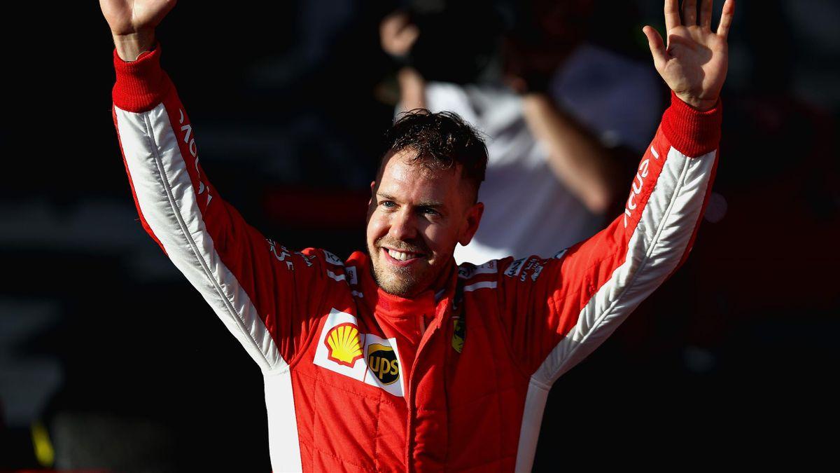 Race winner Sebastian Vettel of Germany and Ferrari celebrates after the Australian Formula One Grand Prix at Albert Park on March 25, 2018 in Melbourne, Australia