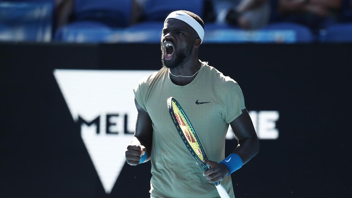Frances Tiafoe of the United States celebrates after winning a point in his Men's Singles second round match against Novak Djokovic of Serbia during day three of the 2021 Australian Open at Melbourne Park