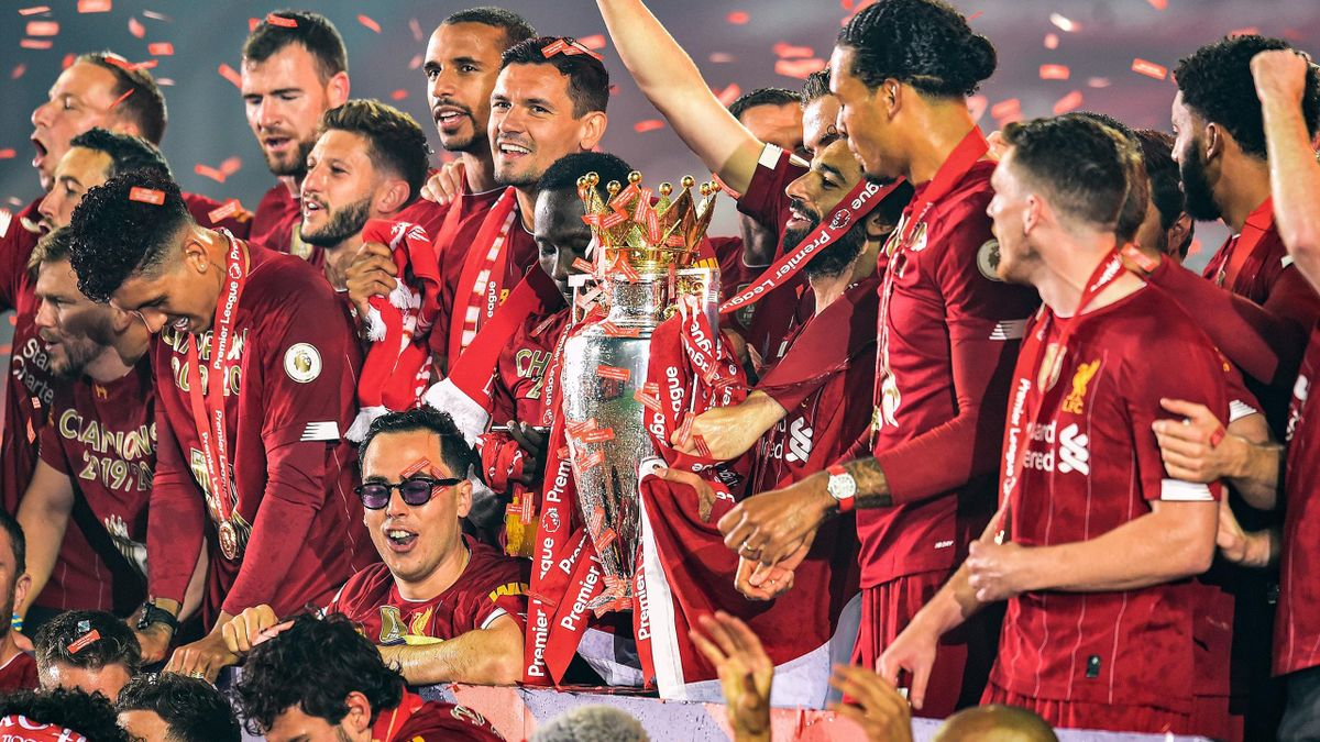 Jordan Henderson captain of Liverpool lifting the Premier League trophy with the rest of the Liverpool team
