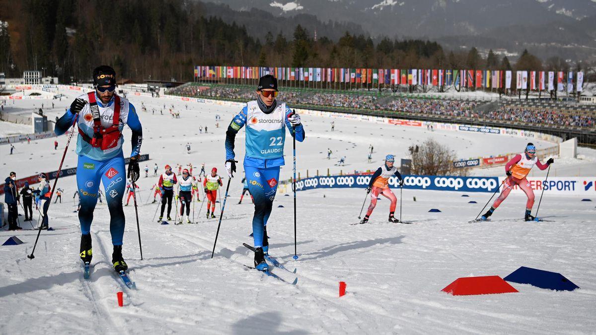 Die Athleten trainieren im WM-Langlaufstadion von Oberstdorf bei strahlendem Sonnenschein
