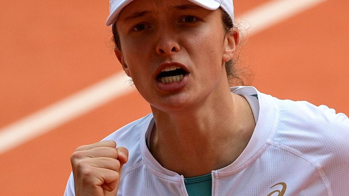 Poland's Iga Swiatek reacts after winning a point against Argentina's Nadia Podoroska