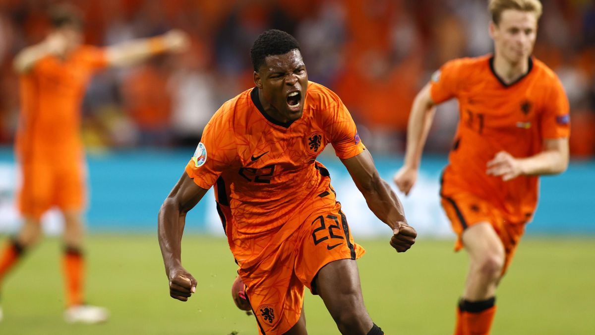 Denzel Dumfries of Netherlands celebrates after scoring their side's third goal during the UEFA Euro 2020 Championship Group C match between Netherlands and Ukraine at the Johan Cruijff ArenA on June 13, 2021 in Amsterdam, Netherlands