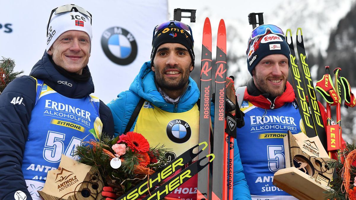 Second-placed Norway's Johannes Thingnes Boe, winner France's Martin Fourcade and third-placed Austria's Dominik Landertinger pose on the podium after the IBU Biathlon World Cup Men's 20km Individual competition in Rasen-Antholz (Rasun Anterselva), Italia
