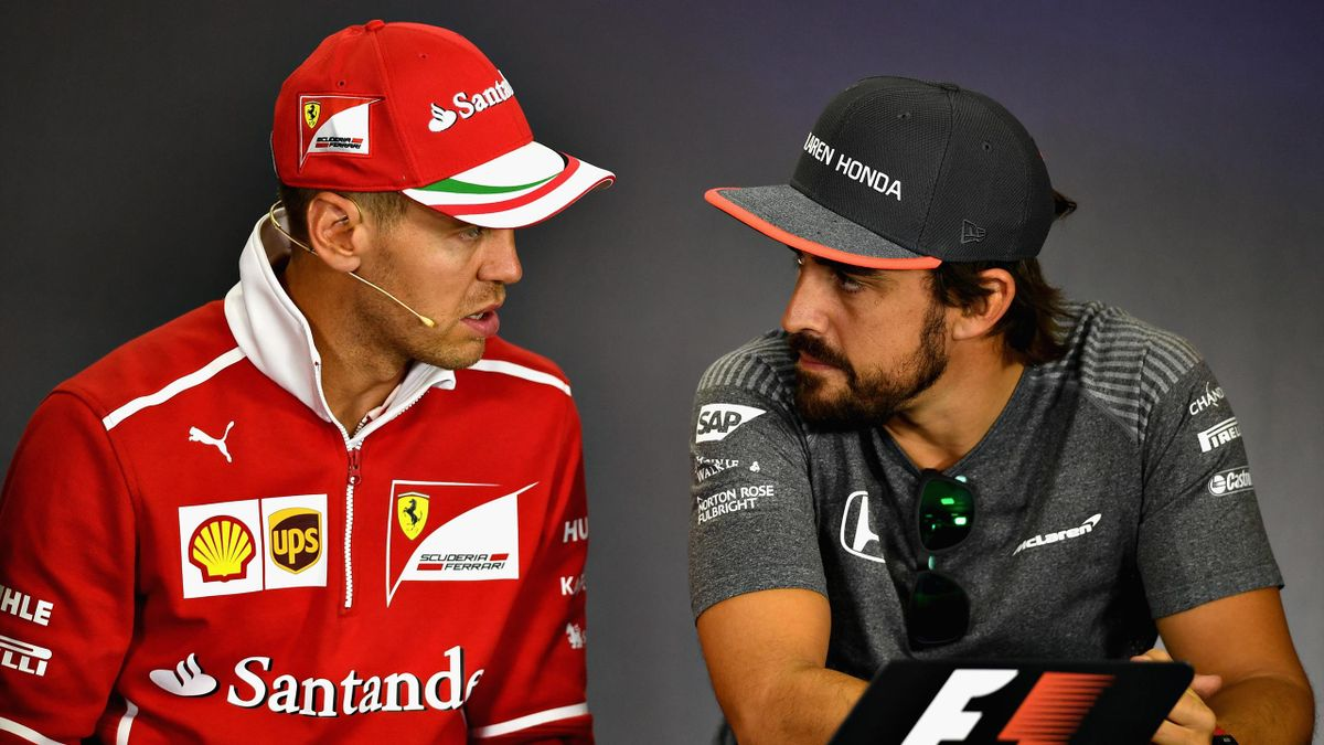 Fernando Alonso of Spain and McLaren Honda and Sebastian Vettel of Germany and Ferrari talk in the Drivers Press Conference during previews ahead of the Formula One Grand Prix of Hungary at Hungaroring on July 27, 2017 in Budapest, Hungary.