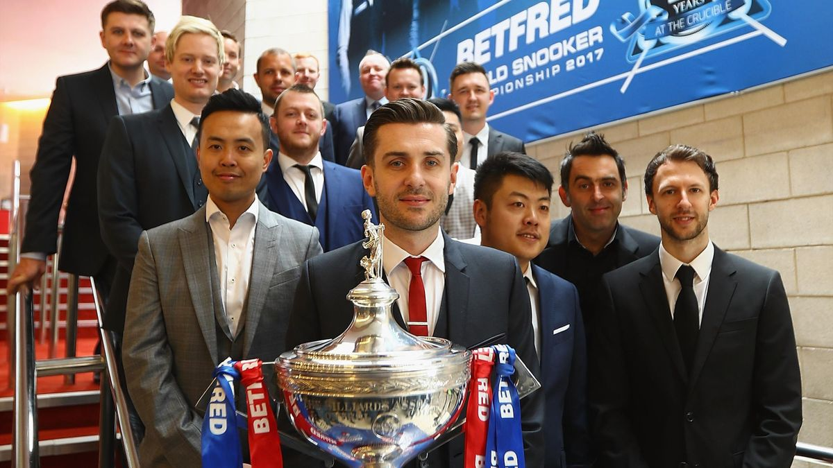 Eye on the prize: Mark Allen pictured left of world champion Mark Selby with the rest of snooker's top 16.