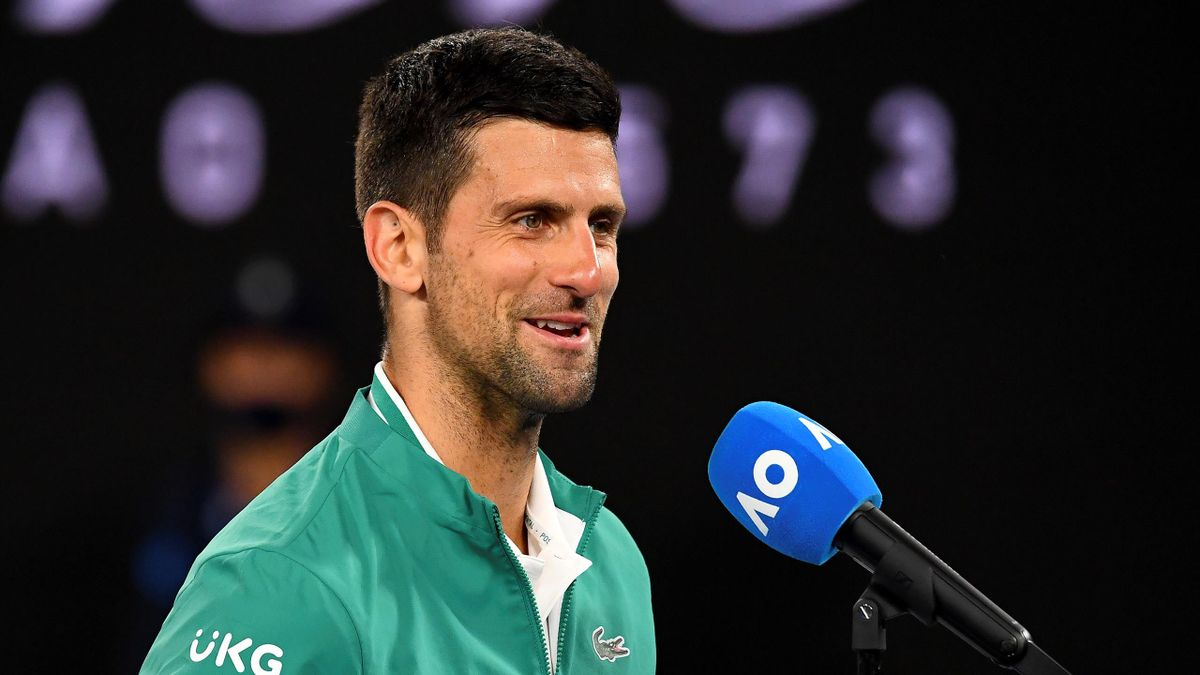 Serbia's Novak Djokovic speaks after celebrations of his victory against Canada's Milos Raonic during their men's singles match on day seven of the Australian Open tennis tournament in Melbourne