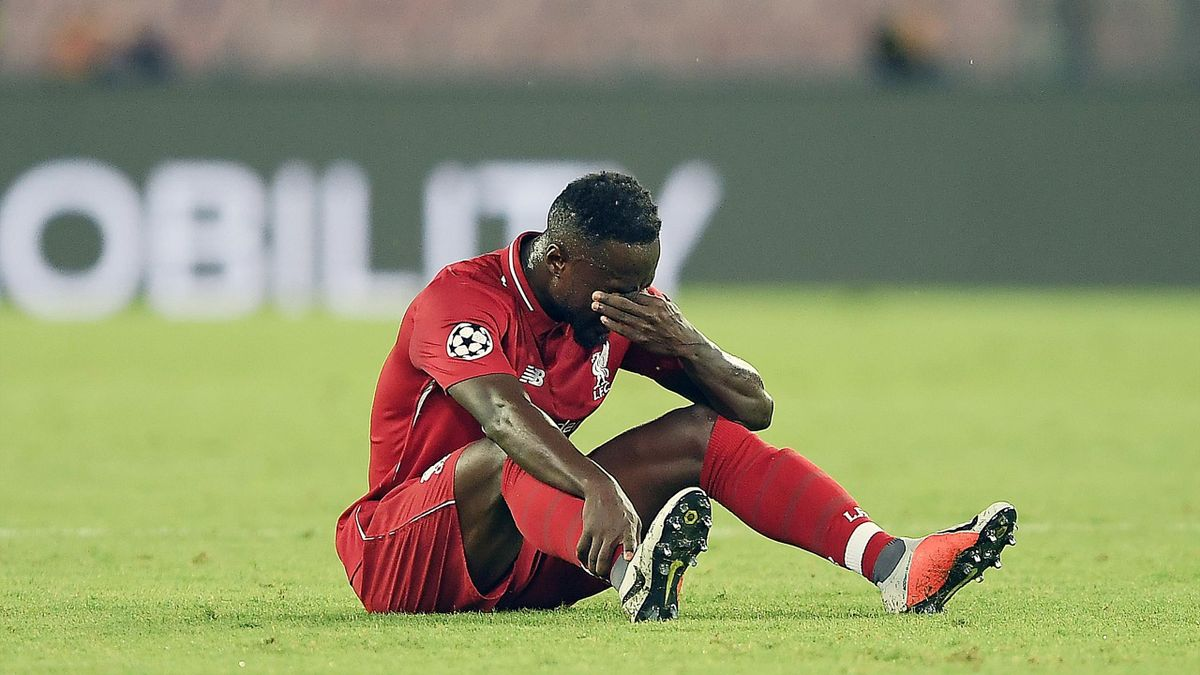Naby Keita of Liverpool injured during the Group C match of the UEFA Champions League between SSC Napoli and Liverpool at Stadio San Paolo on October 3, 2018 in Naples, Italy.