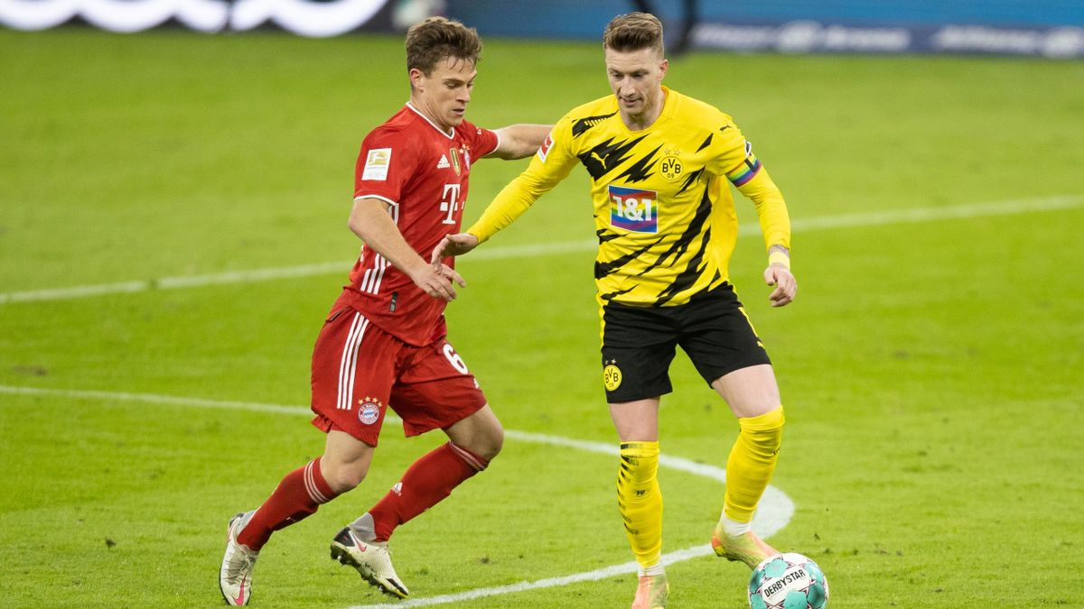 Joshua Kimmich (links; FC Bayern) im Zweikampf mit Marco Reus (Borussia Dortmund)