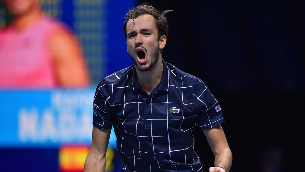 Russia's Daniil Medvedev reacts to breaking the serve of Spain's Rafael Nadal in the third set during their men's singles semi-final match on day seven of the ATP World Tour Finals tennis tournament at the O2 Arena in London