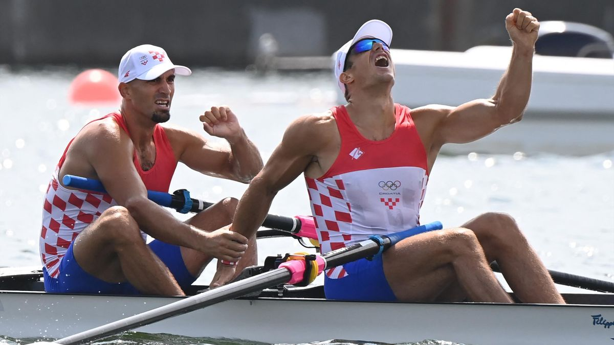 Croatia's Martin Sinkovic and Valent Sinkovicin celebrate winning gold in the men's pair final during the Tokyo 2020 Olympic Games at the Sea Forest Waterway in Tokyo on July 29, 2021.