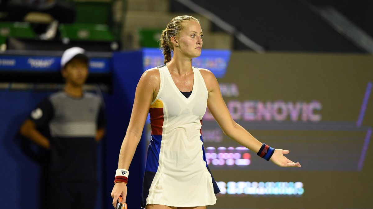 Kristina Mladenovic of France reacts after losing a point against Wang Qiang of China during their first round match in the Pan Pacific Open tennis tournament in Tokyo on September 18, 2017.